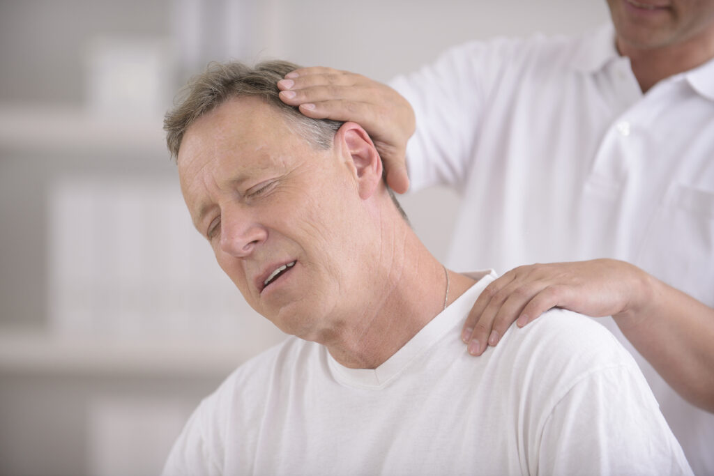 Chiropractic: Chiropractor doing neck adjustment